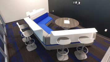 Blue and white lounge furniture with a community table to be used to collaboration purposes.