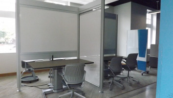 Partitions with white boards and separated for individual use.