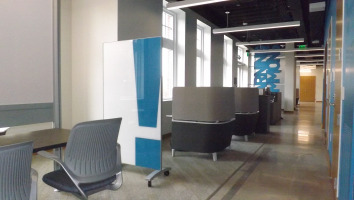 Clarus go!Mobile blue glassboard with light shining on it from windows