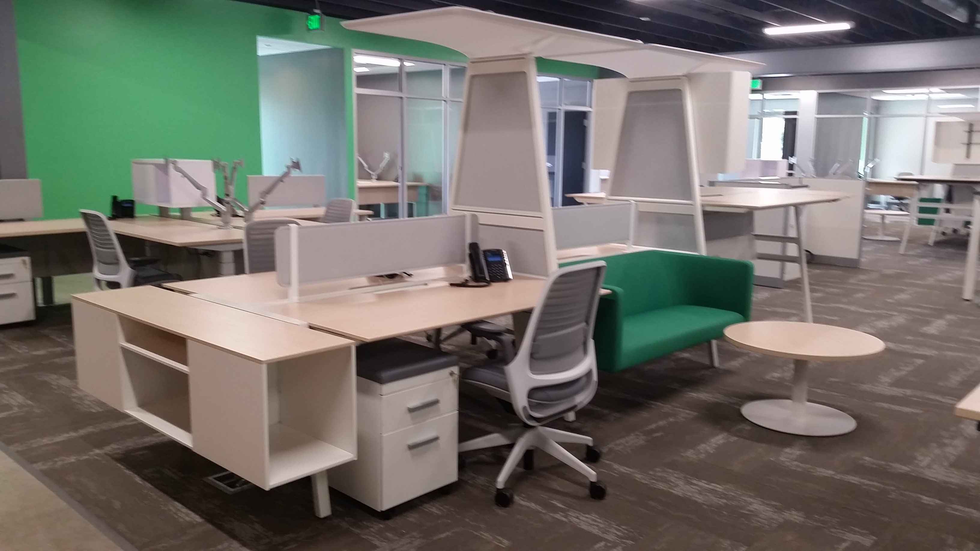 Group desking areas that have high hanging shelf