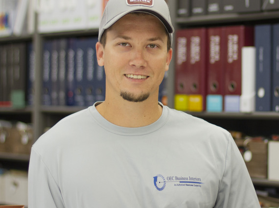 Male installer wearing grey baseball cap and long sleeved shirt while posing for head shot